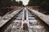 Railway under a thin layer of the first snow. — Stock Photo