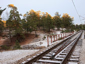 Railway under a thin layer of the first snow. — 图库照片