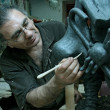 Stock Photo: Sculptor in workshop