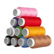 Many-coloured bobbins of thread - Stock Photo