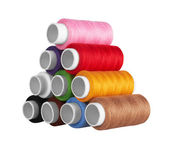 Many-coloured bobbins of thread — Stock Photo