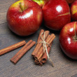 Fresh red apples with cinnamon — Stock Photo