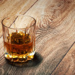 Whiskey in glasses on wooden - Stock Photo