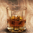 Stock Photo: Whiskey in glasses on wooden