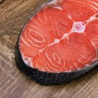 Piece of a salmon on a wood — Stock Photo
