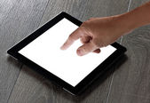 Hand presses on screen digital tablet — Stock Photo