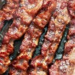 Stock Photo: Bacon slice being cooked in frying pan