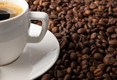 Coffee with coffee-beans — Stock Photo