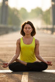 Woman doing stretching yoga exercises outdoors — Stock Photo