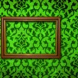 Stock Photo: Gold frame on vintage green wall background