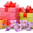 Stock Photo: Beautiful gladiolus and gift boxes on white background.