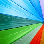 Colourful umbrella background — Stock Photo