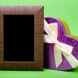 Stockfoto: Wood photo frame and heart gift box with ribbon on green backgro