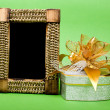 Stock Photo: Wood photo frame and heart gift box with ribbon on green backgro