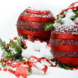 Stock Photo: Christmas tree in the snow with red balls and gift box
