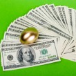 Stock Photo: Golden egg. A symbol of making money and successful investment o