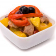 Stewed pork in fruit sauce with sweet pepper. - Stock Photo