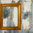 Gold frame on a old wooden wall background. — Stock Photo
