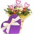 Magnificent bouquet and heart present box on a white background — Stock Photo