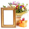 gift box and golden picture frame with flowers on white backgrou — Stock Photo
