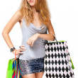 Young happy woman in dress with colorful shopping bags on a whit — Foto Stock