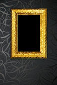 Gold frame on black vintage wallpaper background — Zdjęcie stockowe