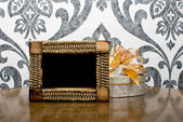 Wooden photo frame and silver present box on table — Stock Photo