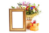 Gift box and golden picture frame with flowers on white backgrou — Foto de Stock