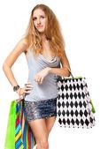 Joven feliz en vestido con coloridos bolsos de compras en un ápice — Foto de Stock