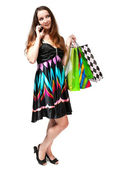 Young woman with shopping bags and mobile phone on a white backg — Stock Photo