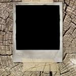 Vintage photo on wooden background — Stock Photo #1831670