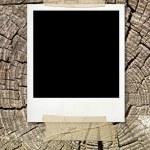 Vintage photo on wooden background — Stock Photo #1863260