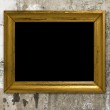 Old grunge wall with vintage gold frame — Stock Photo #2739023