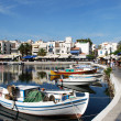 Boats next to a taverna - Stock Photo