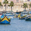 Traditional Luzzu boat at Marsaxlokk harbor in Malta. — Stock Photo #18825125