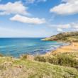 Ramla Bay, on the northern side of Gozo, Malta - Stock Photo