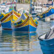 Stock Photo: Traditional Luzzu boat at Marsaxlokk harbor in Malta.
