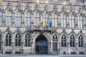 Flags on City Hall facade in Mons, Belgium. — Stock Photo