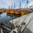 Stock Photo: Orange fishing boats in Mar del Plata, Argentina