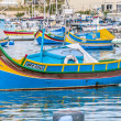 Traditional Luzzu boat at Marsaxlokk harbor in Malta. — Stock Photo