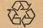 Recycle symbol on a cardboard — Stock Photo
