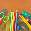School supplies on wooden table — Stockfoto #12225362