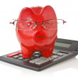 Calculator and piggy-bank — Stock Photo