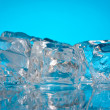 Ice cubes on a blue background — Stock Photo