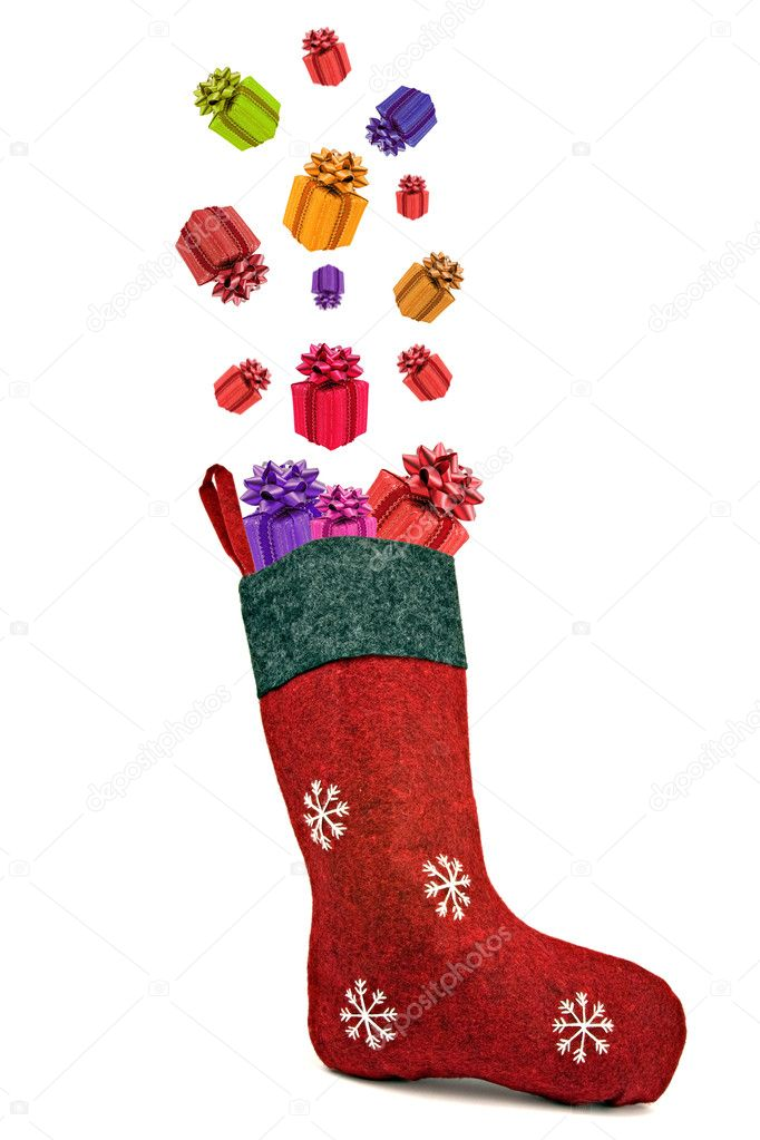 Gifts coming out of red christmas sock. Isolated on white background.  Stock Photo #13545935