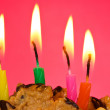 Birthday candles against red background — Stock Photo