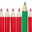 Royalty-Free Stock Photo: Many red pencils and one green