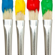Stock Photo: Four paintbrushes with color paints