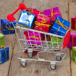 Stock Photo: Cart with colorful gift boxes