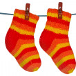 Knitted socks hung on the rope — Stock Photo